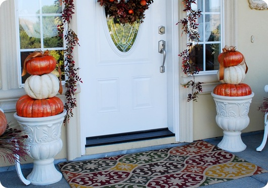 pair of urns with pumpkins