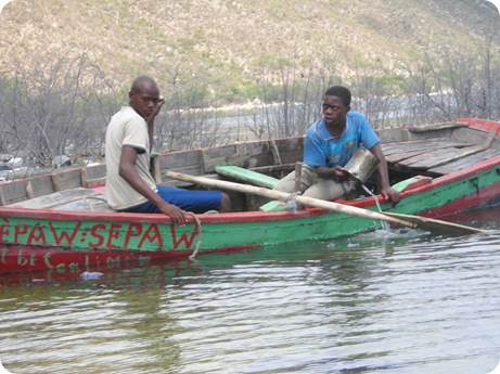 haitian men in canoe