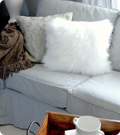 white faux fur pillow in guest house