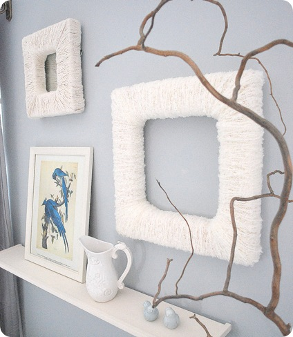 yarn wrapped frames behind branch