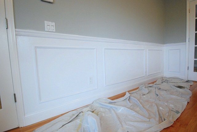 once the spackling was dry i gave my new wainscoting a coat of white paint