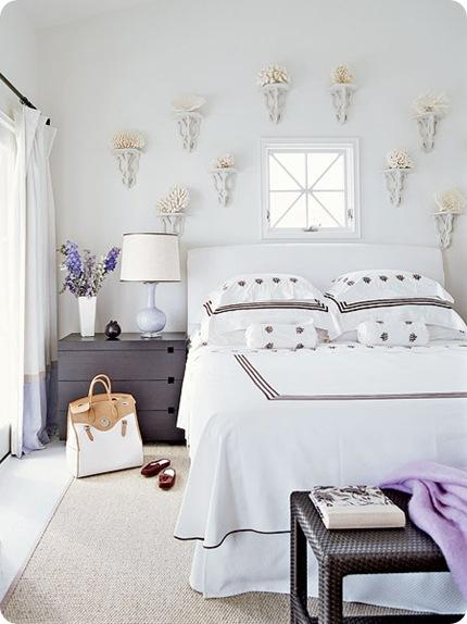 coastal living decor above bed white room