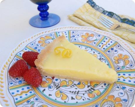 lemon tart slice with raspberries