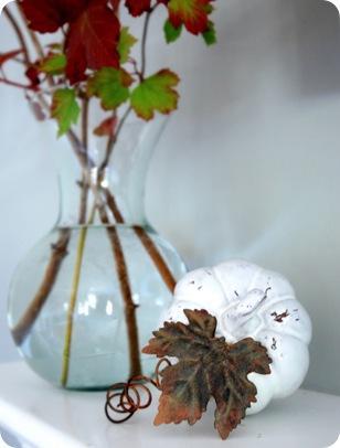 white pumpkin on mantel