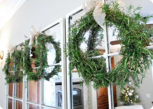 3 rosemary wreaths on mirror
