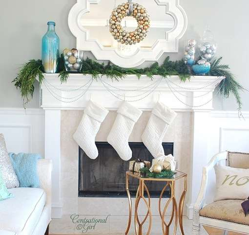 Carolers Displayed On A Mantle With Garland And Stockings: Our Home For The Holidays