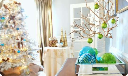 green ornaments on branches