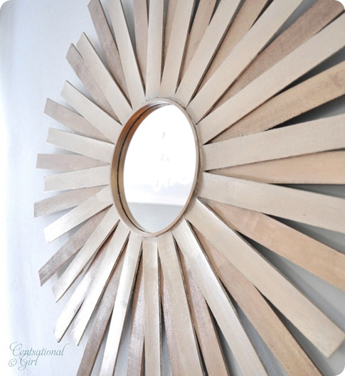 cg sunburst mirror on wall