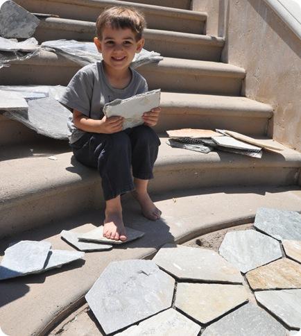 boy with stone