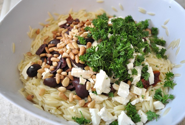 ... , kalamata olives, sundried tomatoes, pine nuts and parsley on top