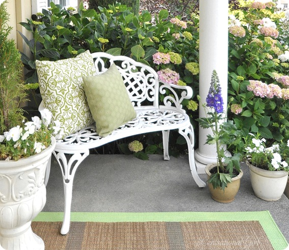 white bench green pillows hydrageas