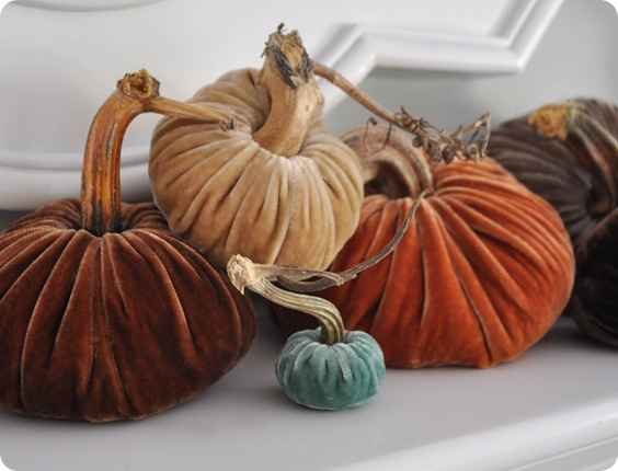 plush pumkins on mantel