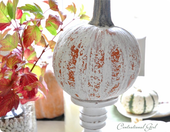 distressed pumpkin on stand