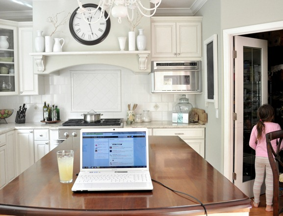 laptop on kitchen island