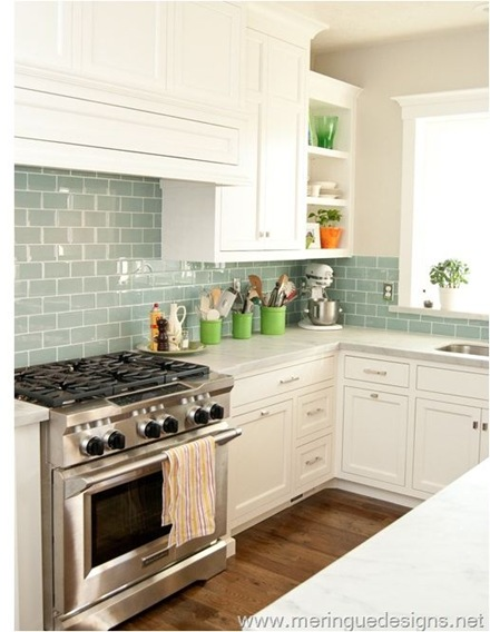 We Re Loving The Blue Glass Tile Backsplash And New White Cabinets