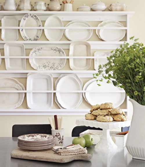 white platters on dish rack