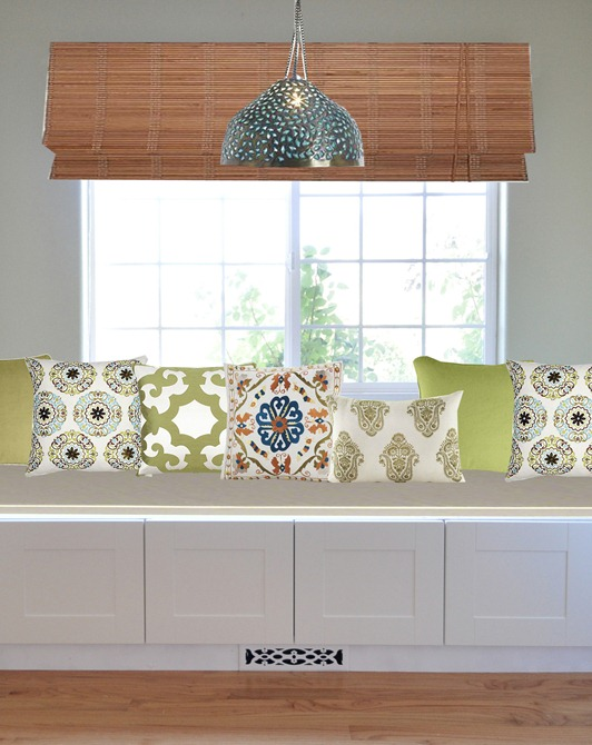 global inspired pillows on window seat
