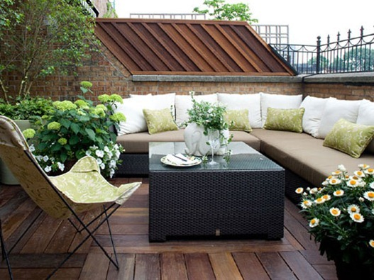 soft green pillows on patio