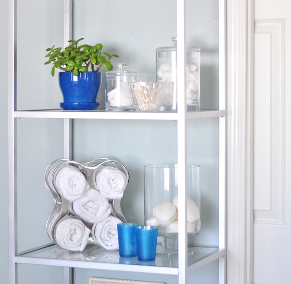 toiletries and handtowels on shelves