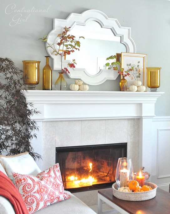 amber bottles and mirror on mantel
