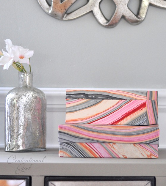 stacked marbled paper boxes cg