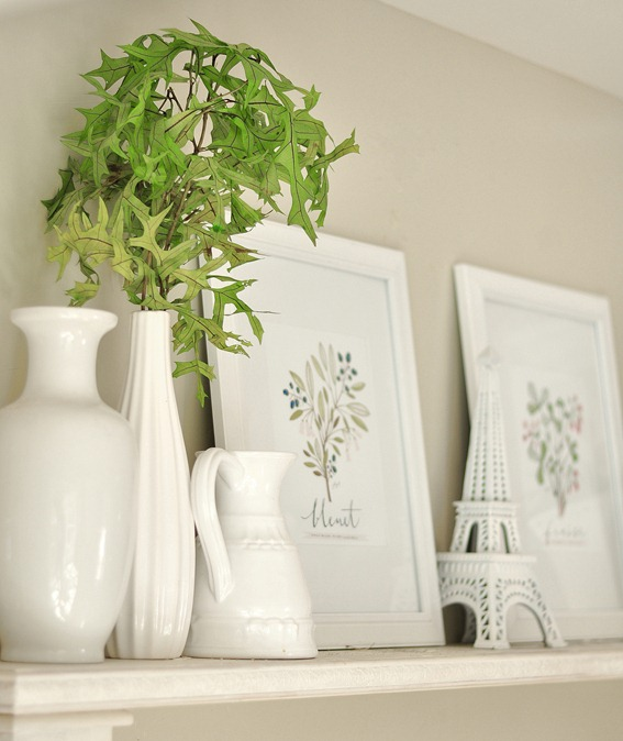 vase and prints on mantel