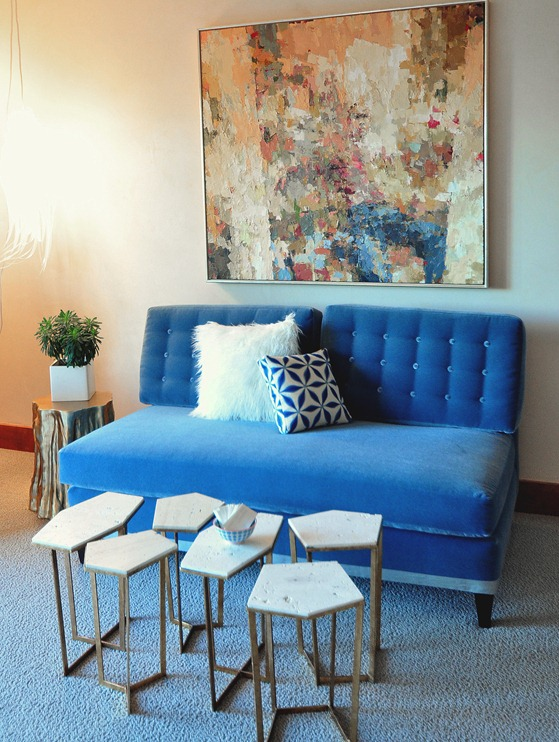blue sofa and abstract art