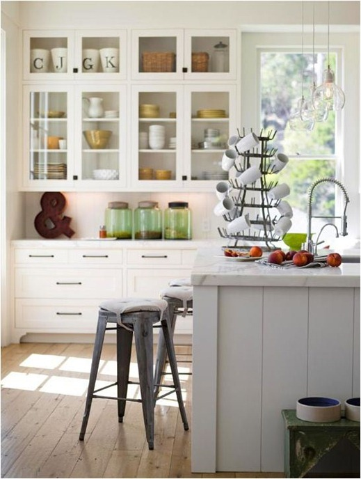 gray island white surround cabinets bhg