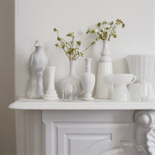 simple white vessels on mantel