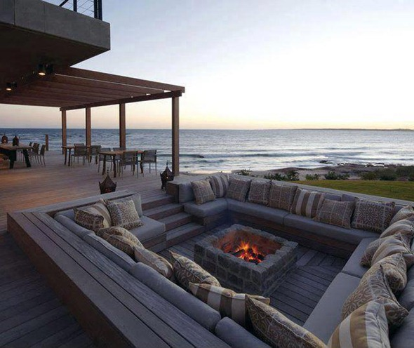 built in outdoor firepit by ocean
