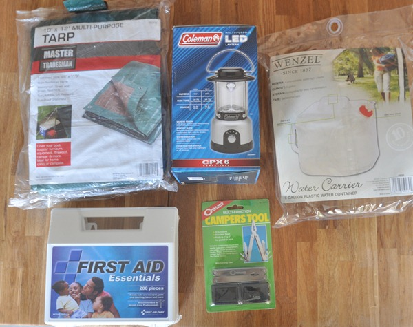 tarp lantern water carrier camper's tool first aid kit