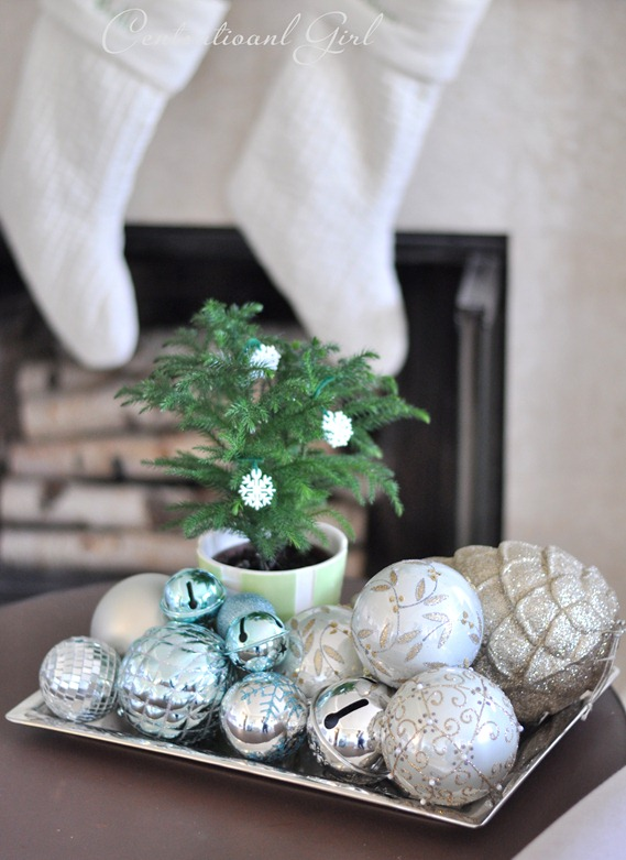 pile of ornaments on silver tray