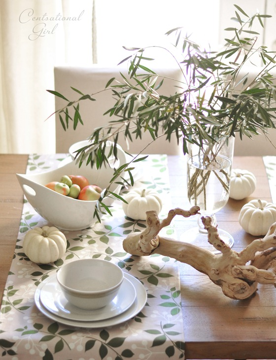 white dishes and grapevine accent