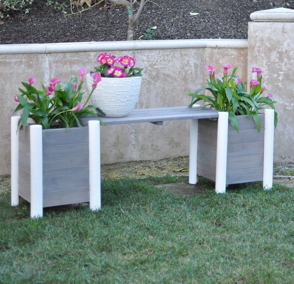 gray and white bench with planters