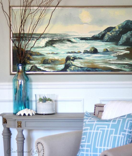 seascape painting and terrarium