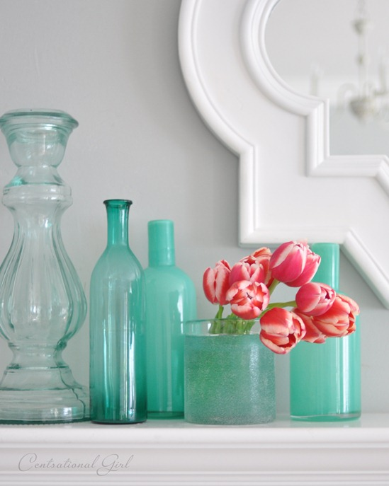 coral tulips in blue vases
