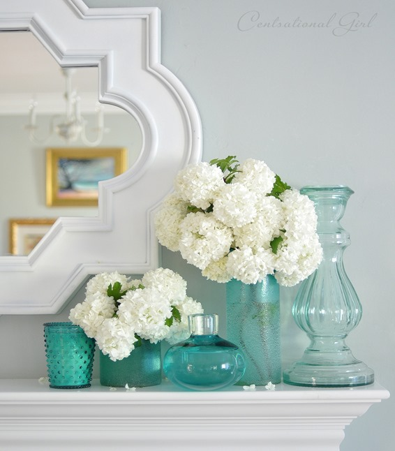 viburnum in blue glass vases