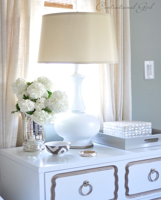 viburnum in vase on nightstand