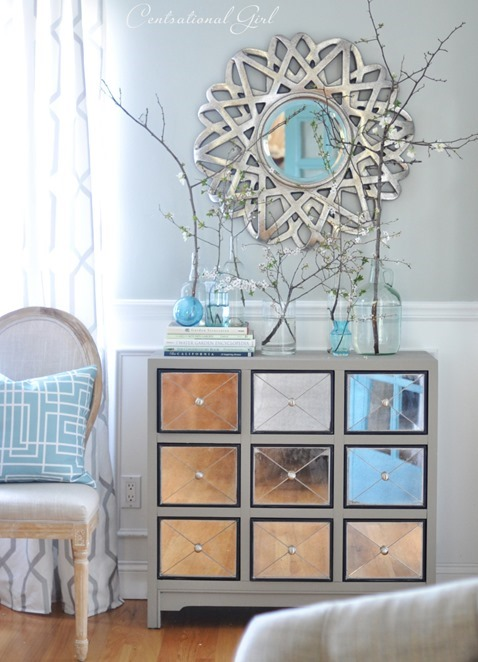 living room mirror and chest