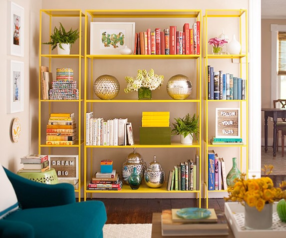 yellow painted bookshelves bhg