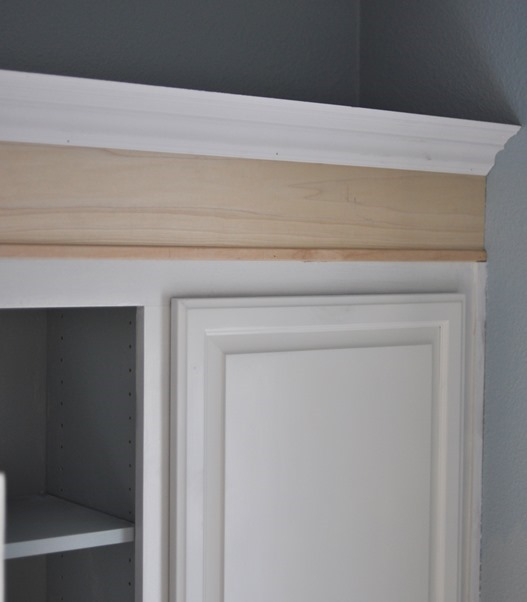 was primed and painted like the cabinets and the walls were painted