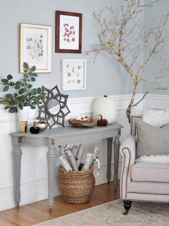 gray console with leaf prints