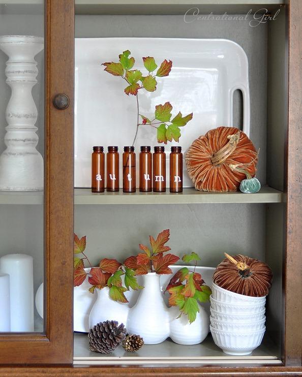 autumn bottles in hutch