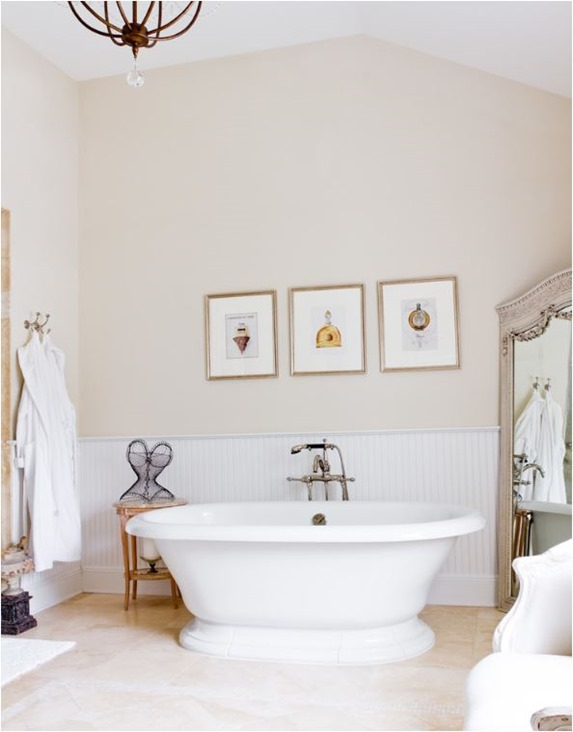 bathtub and statement mirror