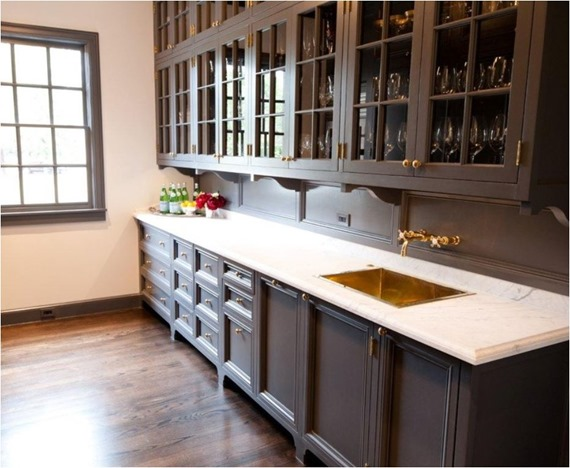 brass knobs gray cabinetry