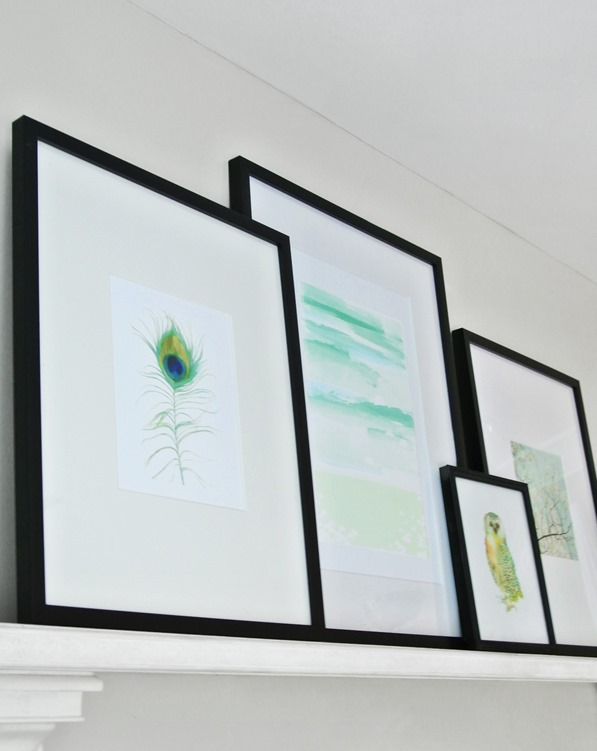 framed art on mantel