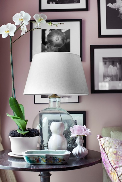 pale pink walls with black & white photos