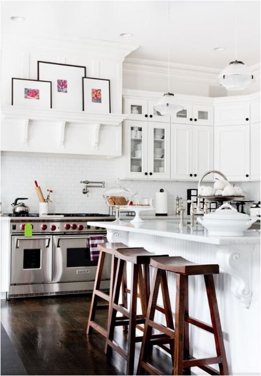 white kitchen dark floors and barstools