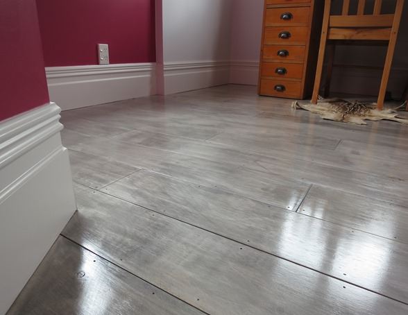 gray painted plywood plank floors
