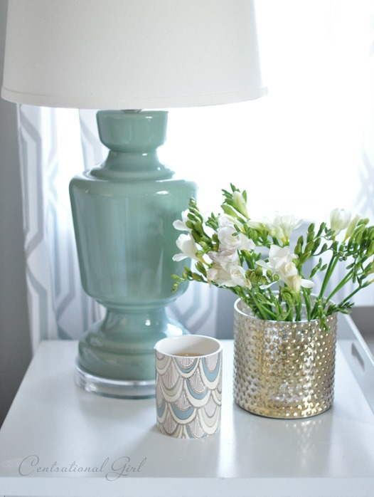 lamp and flowers on nightstand